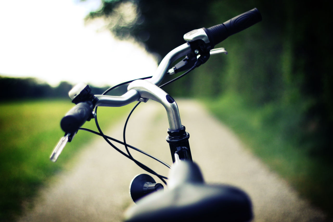 Handlebar of standing bicycle in green nature Bicycle Close-up Day Forest Handlebar Land Vehicle Nature No People Outdoors Outside Pathway Switzerland Track Transportation Way