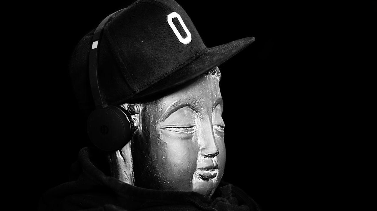 human representation, male likeness, statue, studio shot, black background, night, headwear, sculpture, no people, indoors, close-up