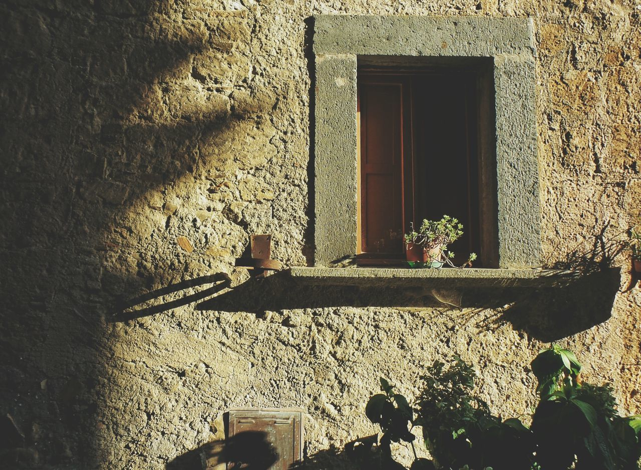 the end of a Summer Sunny Afternoon in Civita Di Bagnoregio Window Built Structure Architecture No PeopleIlluminated Day Close-up Ancient Old House Old Shadow Shadows & Lights Simple Things In Life Simplicity Lookbeyond Countrylife Simple Moment Home Enjoy The New Normal Homelife