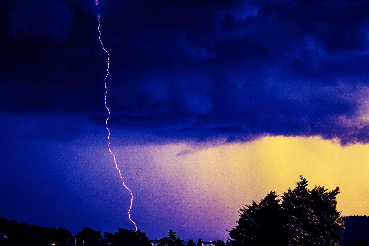 Strike , Lightning Capture, Branchless lightning lLightningtThunderstormcCloud - SkysSkysStorm CloudSStormWWeatherDDramatic Sky pPower In NaturenNo PeopleTTreeLLow Angle ViewNNatureaAtmospheric MoodeElectricity SSilhouettenNightoOutdoorssScenics((null)mMountains And SkypPower In Nature