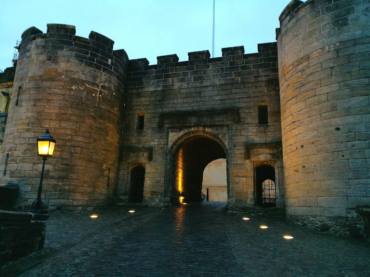 architecture, built structure, building exterior, arch, history, illuminated, castle, outdoors, no people, sky, day