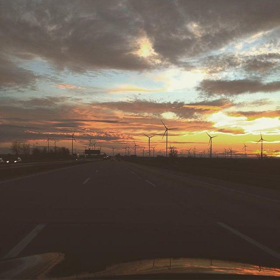 Germany Sachsenanhalt Burgenlandkreis Saalelandkreis Weißenfels A9 E49 E51 Goldenhour Sunset Cominghomeforchristmas watching how the Sun and Wind Windmills producing Renewanleenergy while burning Fossilfuel on German Autobahn with my rental car giving me some Headache