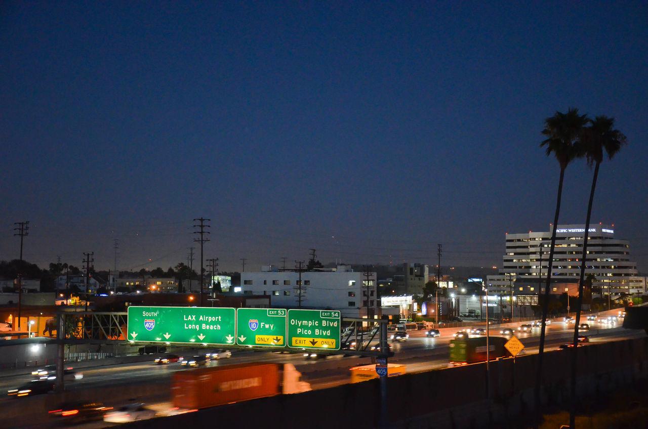 Slip Stream Cars Direction Economy Highway Illuminated Journey LAX Lights Los Angeles, California Modern Nicht Night Palm Tree Paths Road Road Sign Road Trip Roadtrip Society Traffic Trails Transportation Travel Truck Ways