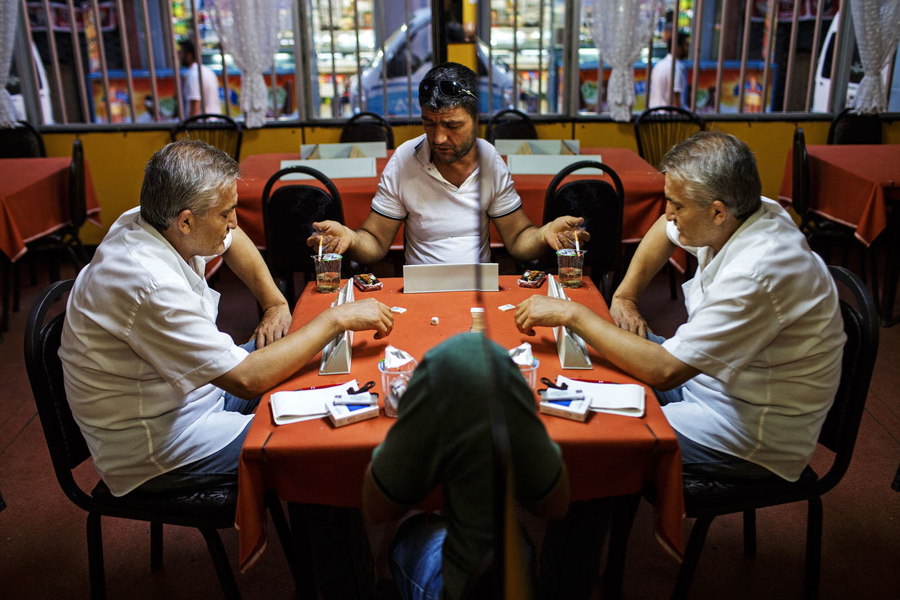 A game of cards in a small tea shop/social club in the Fatih area of Istanbul, Turkey. Istanbul Mirror Pastime Playing Cards Street Photography Streetphotography Tea Turkey
