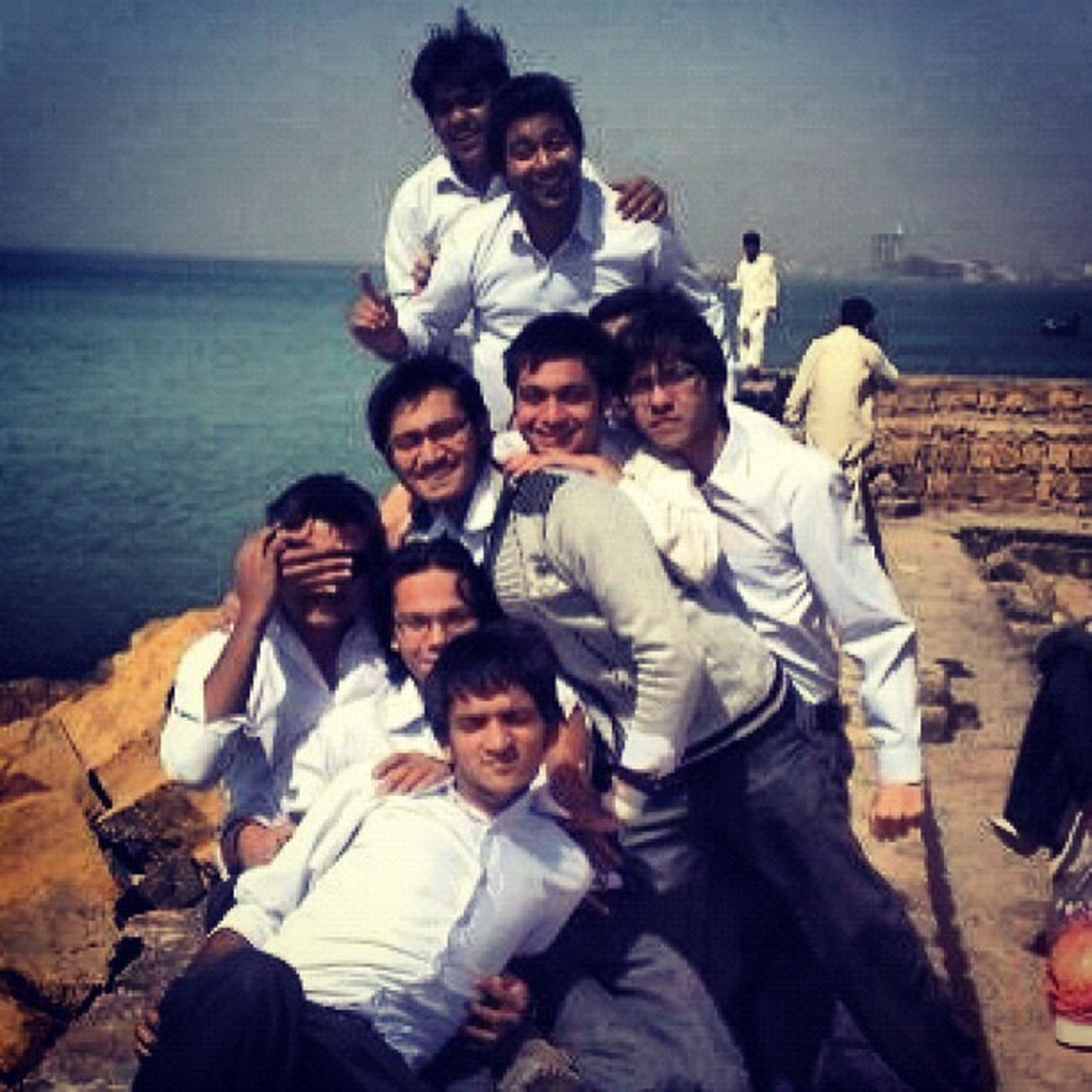 togetherness, lifestyles, bonding, leisure activity, love, person, water, young men, casual clothing, boys, friendship, family, childhood, happiness, sea, vacations, smiling, sitting