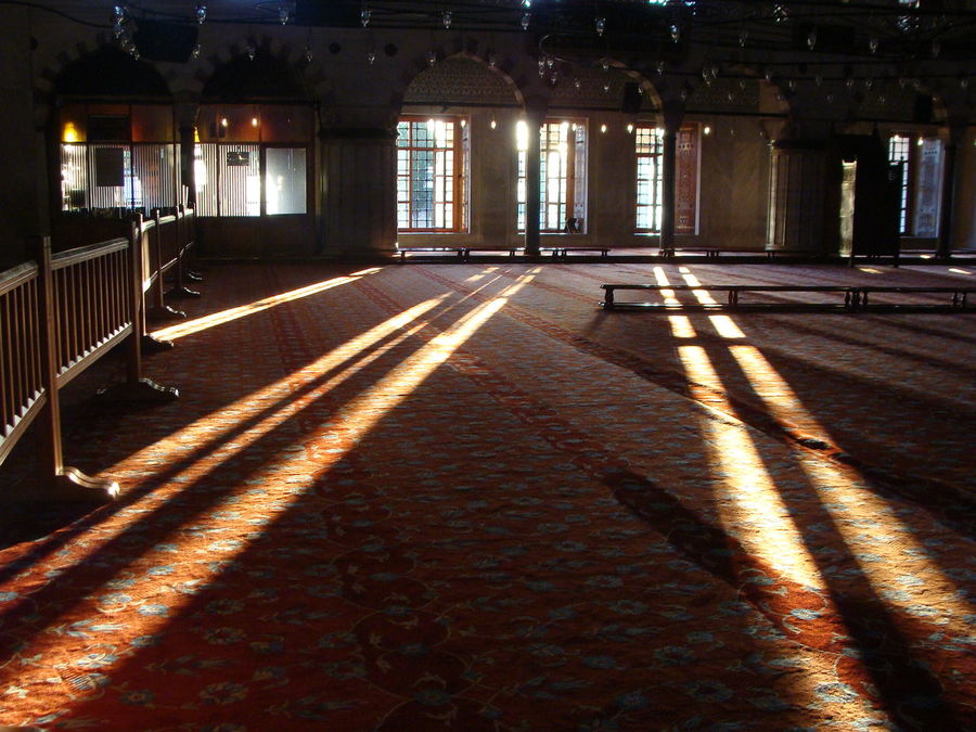 Rays of early morning sunlight cut across the carpeted floor of the Blue Mosque , Istanbul After The Fajr Prayers Architecture Built Structure Darkness Flees Day Indoors  Istanbul Light Dawns Morning Light No People Place Of Worship Rays Of Sunlight Shadow Sultanahmet Sunlight The Blue Mosque Travel Travel Destinations Worship