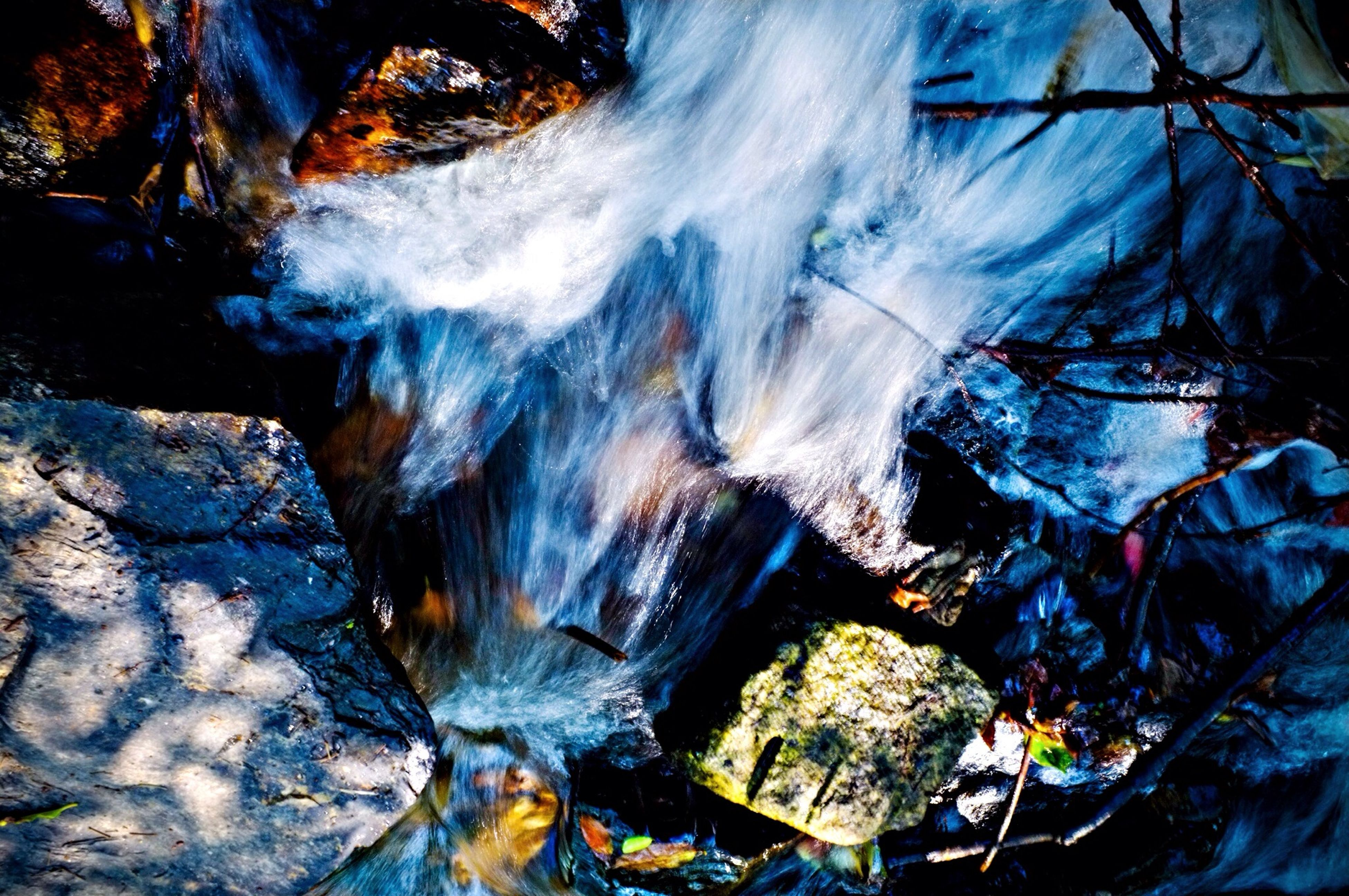 rock - object, close-up, nature, water, high angle view, motion, outdoors, heat - temperature, no people, day, season, firewood, burning, beauty in nature, ice, wood - material, frozen, rock formation, natural pattern, log