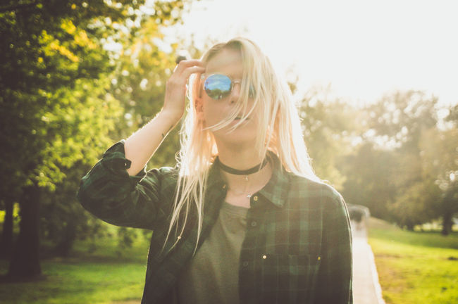 Adult Adults Only Beauty Blond Hair Casual Clothing Close-up Day Front View Fun Headshot Leisure Activity One Person Only Women Outdoors People Portrait Sunlight Tree Young Adult Youth Culture