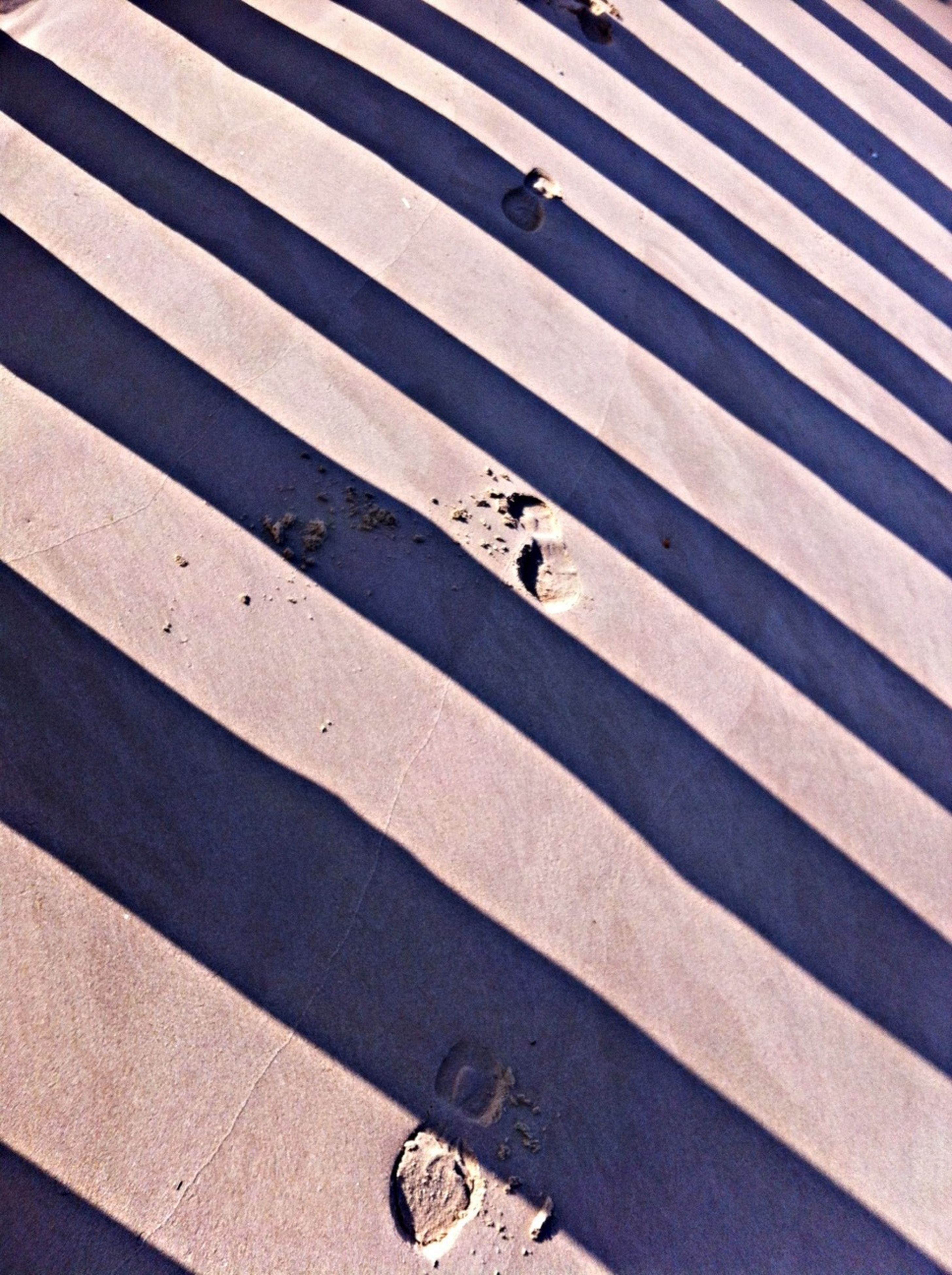 road marking, high angle view, shadow, street, walking, lifestyles, transportation, road, men, zebra crossing, sunlight, leisure activity, asphalt, low section, person, unrecognizable person, day