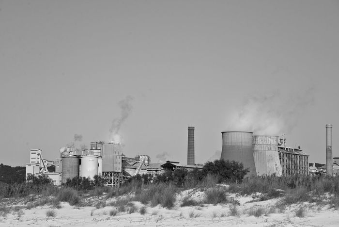 Air Pollution Smoke - Physical Structure No People Factory Outdoors Social Issues Industry Light Looking Into The Future Coastline Exploring Black&white Building Factory Chimney Smog In The Sky Dramatic Sky Future Industrial Landscapes
