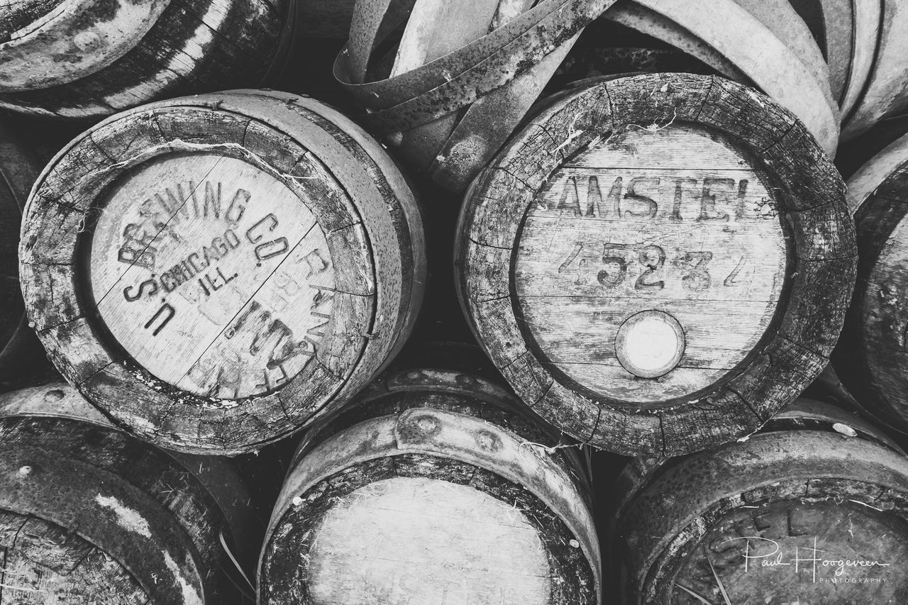 Vintage barrels Abundance Alcohol B&w Backgrounds Barrel Black And White Bw_collection Close-up Day Full Frame Monochrome No People Number Stack Text Wine Cask
