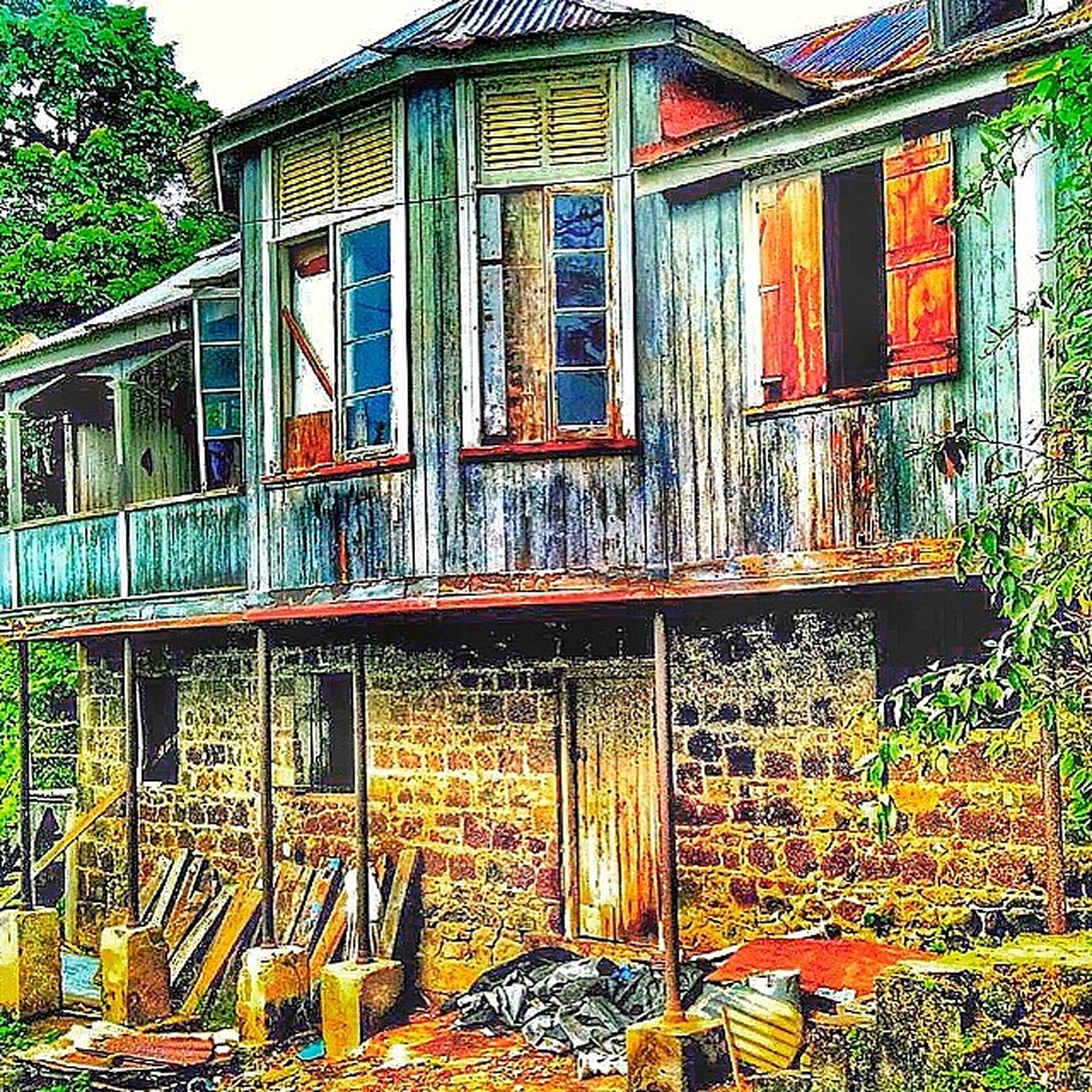 building exterior, architecture, built structure, house, window, residential structure, residential building, door, day, tree, closed, outdoors, no people, wood - material, building, multi colored, old, facade, entrance, blue