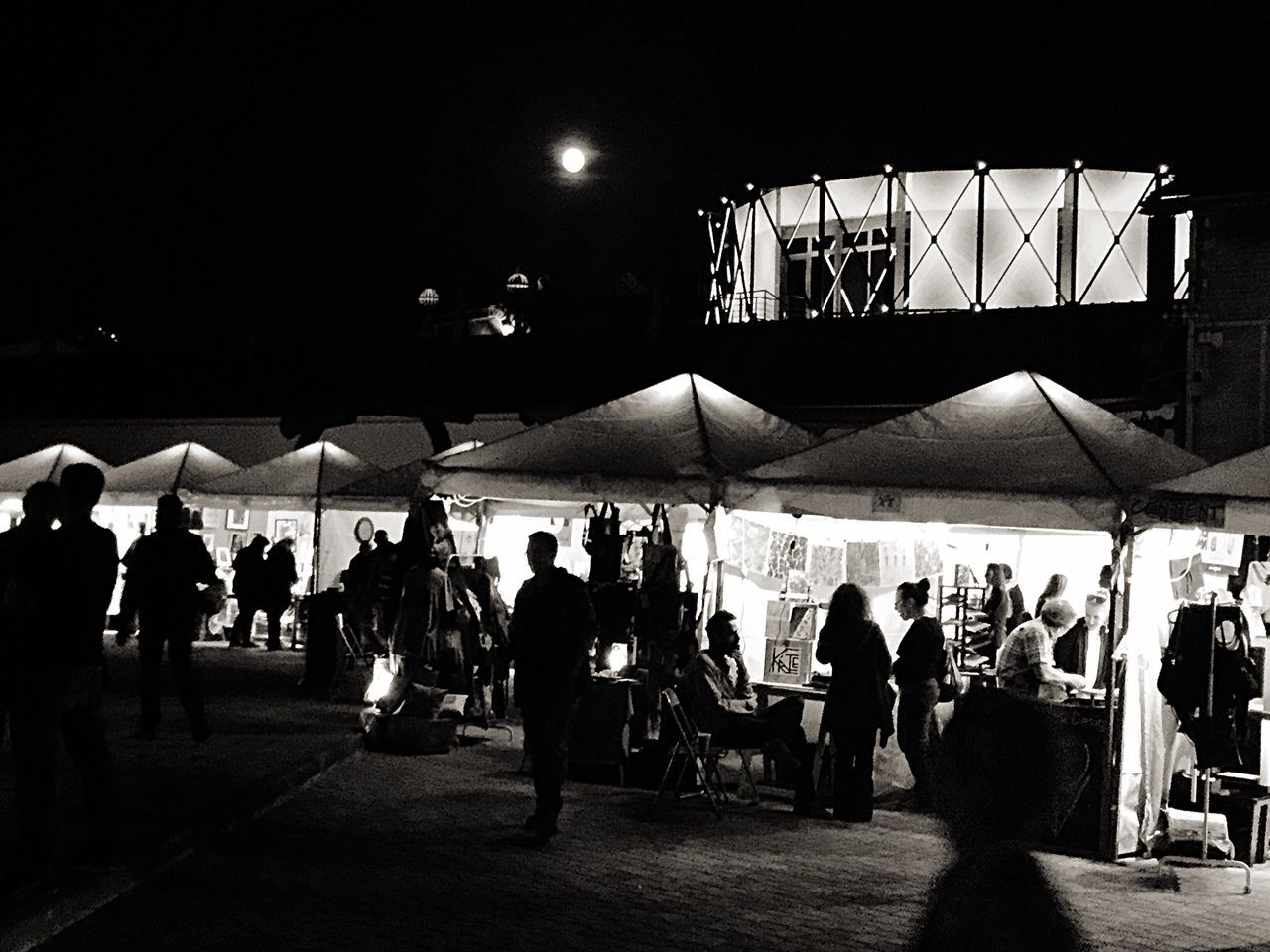 Large Group Of People in a Fleemarket Bazaar Illuminated by the October ' s Full Moon Light And Shadow Dark Silhouette_collection for Bnw_friday_eyeemchallenge in Athens