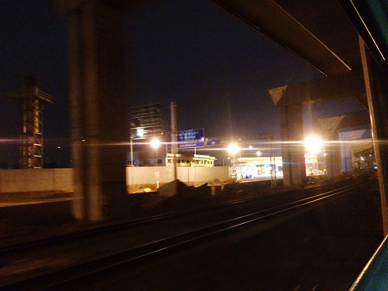 illuminated, night, rail transportation, railroad track, transportation, public transportation, train - vehicle, railroad station, railroad station platform, built structure, no people, architecture, indoors, city, sky
