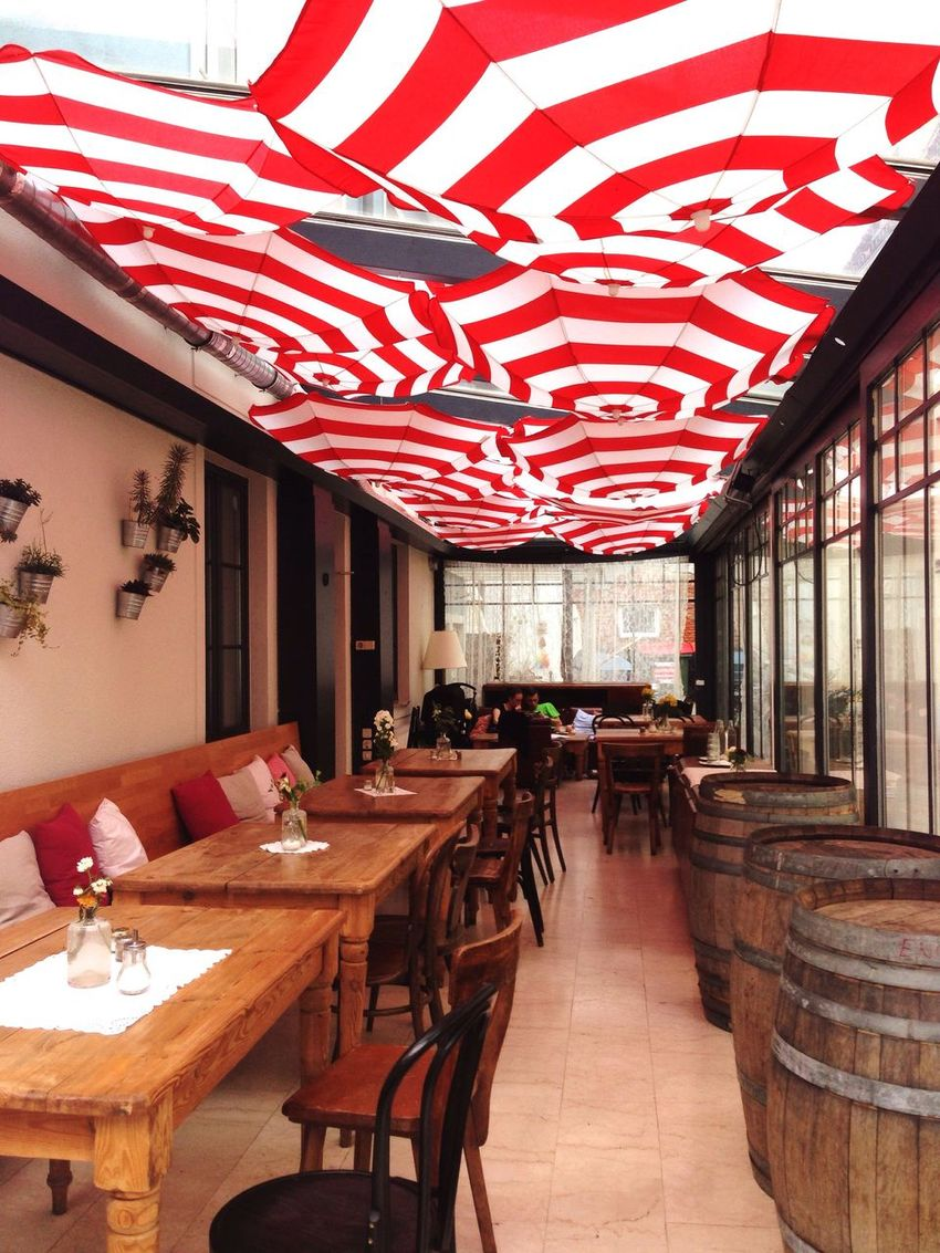 Umbrellas Interior Design Ceiling Hanging Umbrellas Red And White Stripes Graz Barrels Chairs Tables And Chairs Caffee