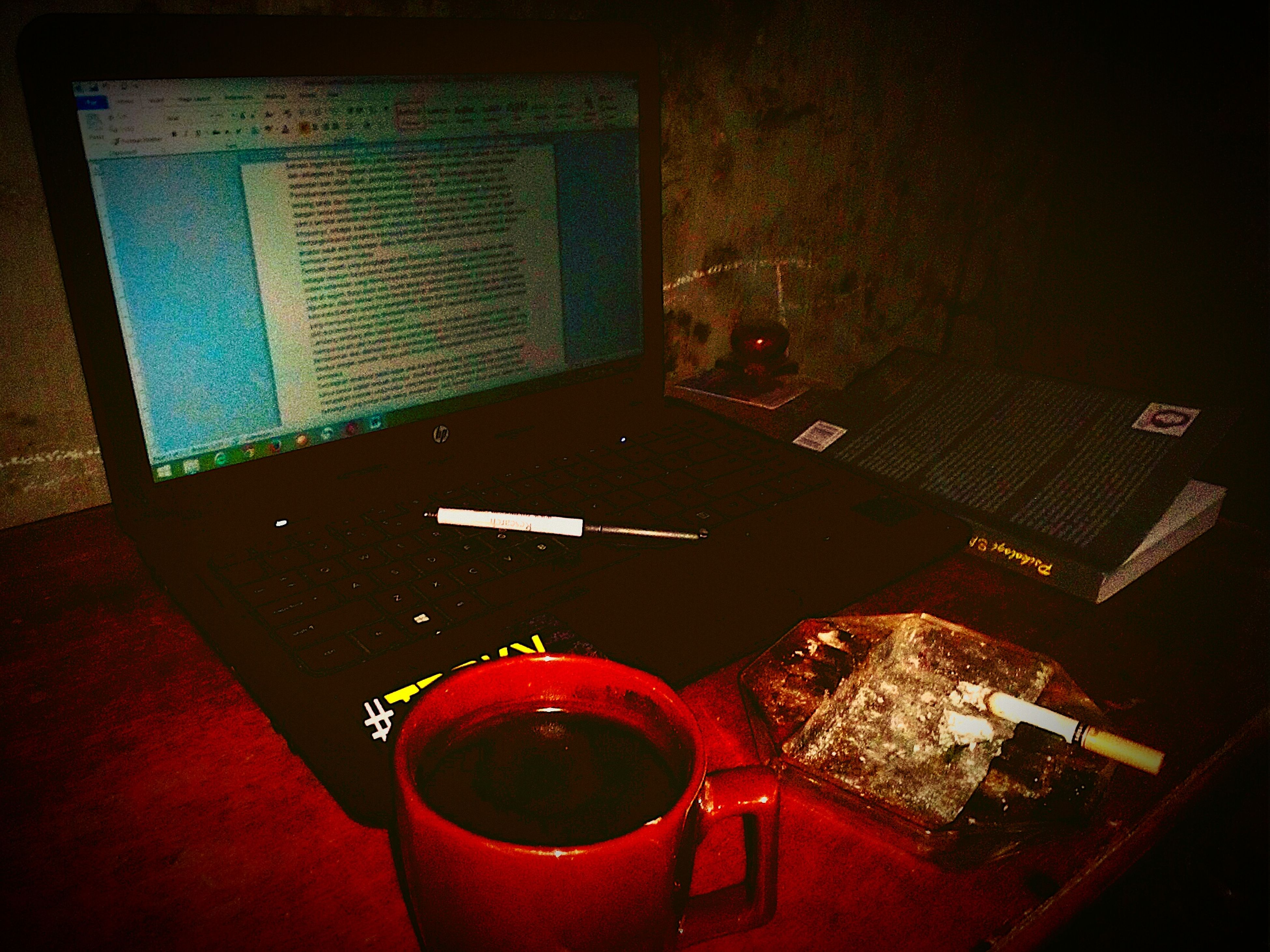 indoors, table, communication, high angle view, technology, still life, transfer print, red, auto post production filter, illuminated, wireless technology, home interior, close-up, no people, text, connection, absence, western script, chair, laptop