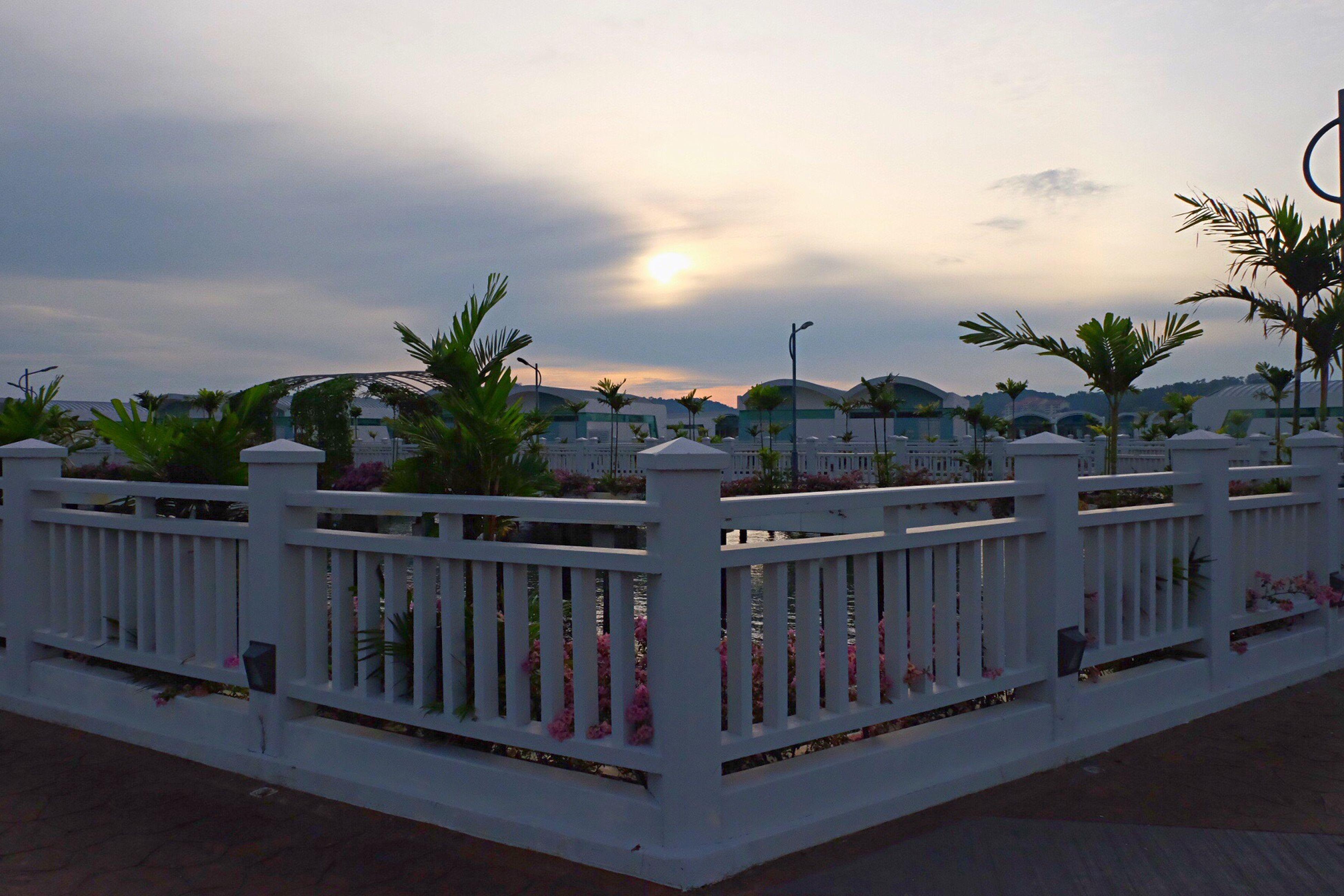 sky, cloud - sky, architecture, cloud, building exterior, water, outdoors, vacations, storm cloud, sea, sun, tourism, tourist resort, no people