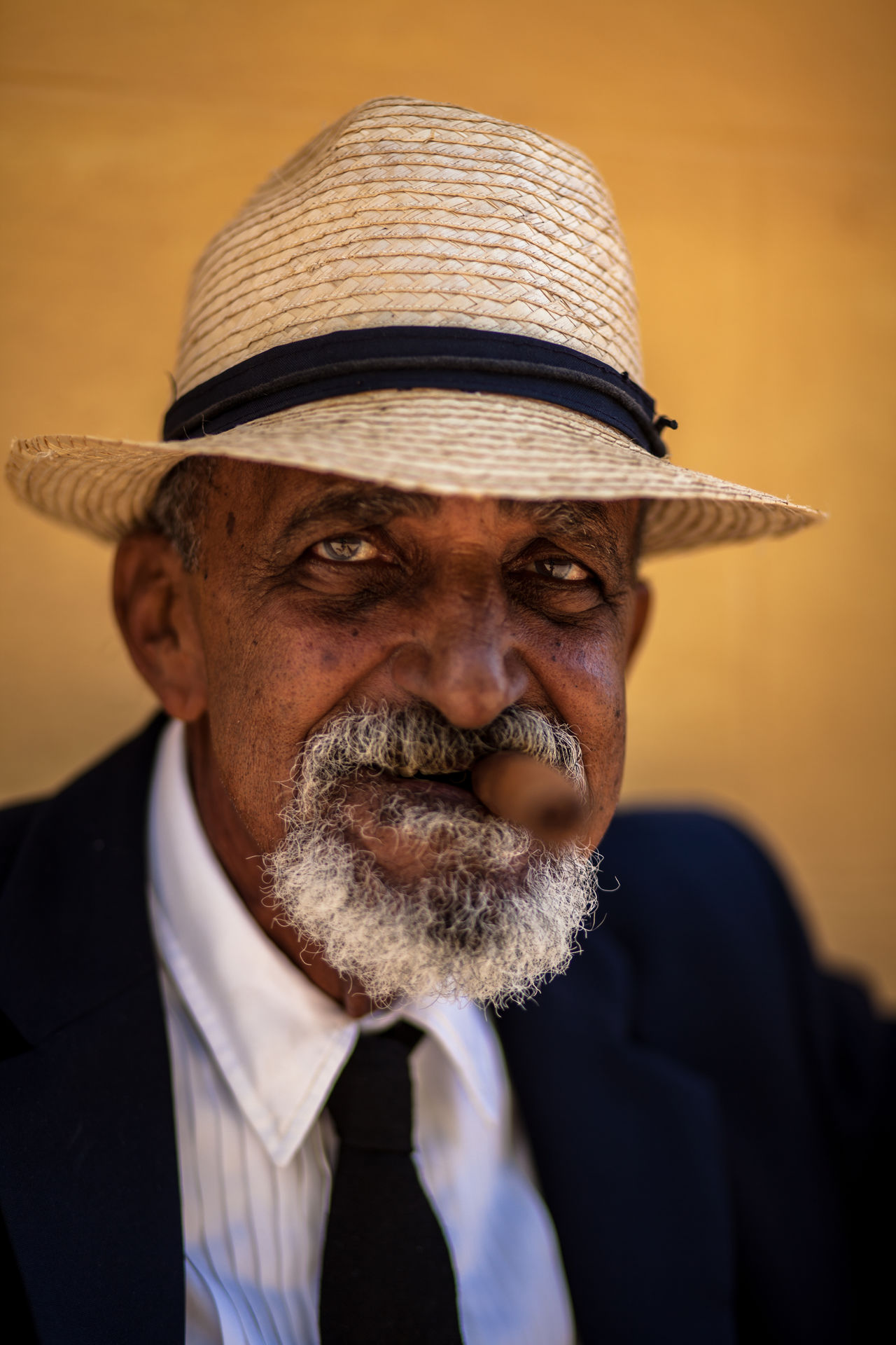 A cuban man poses for tourist' pictures. Cuba Cuban Leisure Activity Lifestyles Man Mid Adult Men Old Man People Person Portrait Portrait Photography Sigar Smoke Strawhat Strawhatportraits Trinidad Trinidad, Cuba