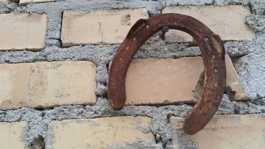 Horseshoer Lucky Charm Backgrounds Brick Wall Close-up Concrete Day Detail Deterioration Ferratura Ferro Di Cavallo Full Frame Geometric Shape Horseshoe Maniscalco No People Old Outdoors Portafortuna Run-down Shoeing