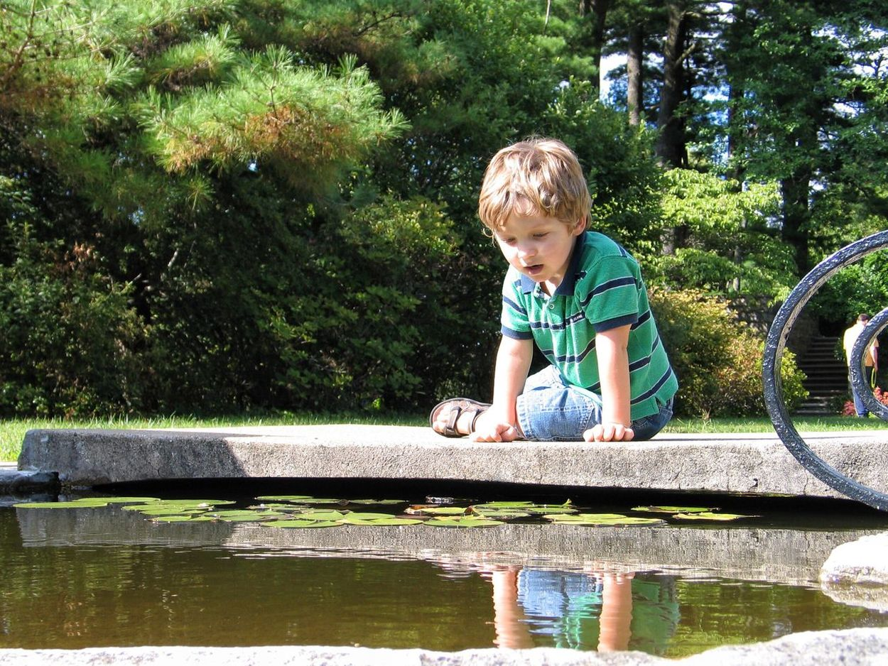 EyeEm Selects Real People Day One Boy Only Boys Childhood Full Length Tree Casual Clothing Looking Down Water One Person Outdoors Playing Males  Children Only Blond Hair Nature People Owe Waching Reflection In Water