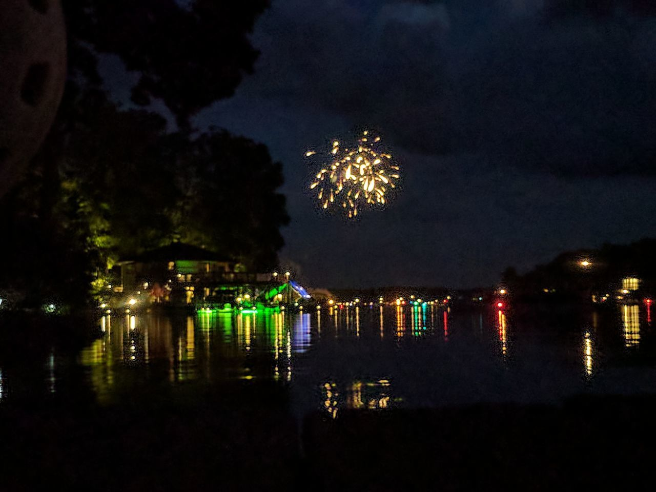 Night Exploding Firework Display Celebration Firework - Man Made Object Sky Reflection Arts Culture And Entertainment Illuminated Water No People Outdoors Multi Colored Beach Reflection Cityscape Landscape Ferris Wheel Tree City Boats Lights
