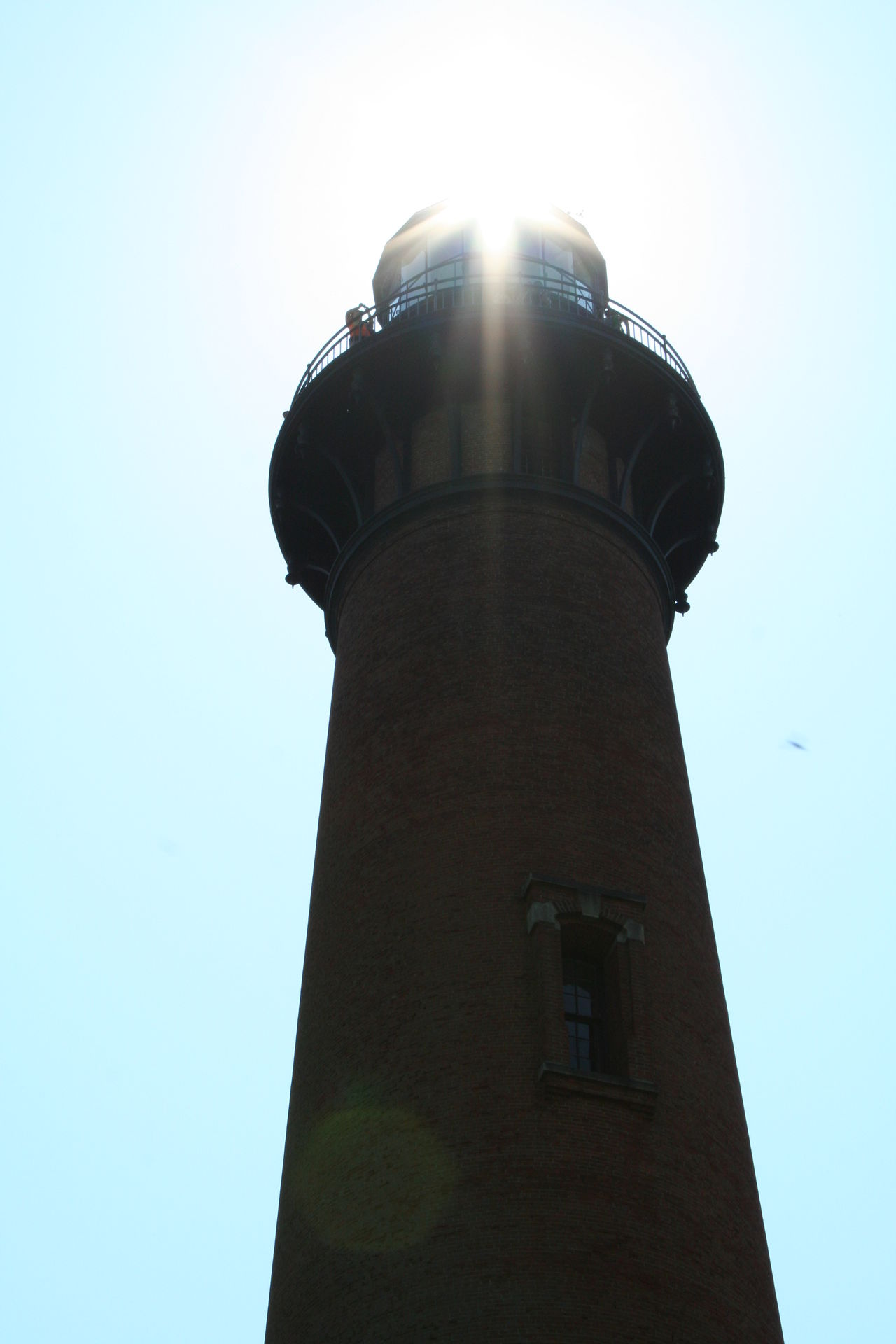 Loved this angle...waited for the sun to get directly over the lighthouse and snapped it as if the sun was the glow from the top of the lighthouse Architecture Built Structure Clear Sky Currituck Beach Lighthouse Lighthouse Lighthouse OBX Outer Banks NC Sun Tower