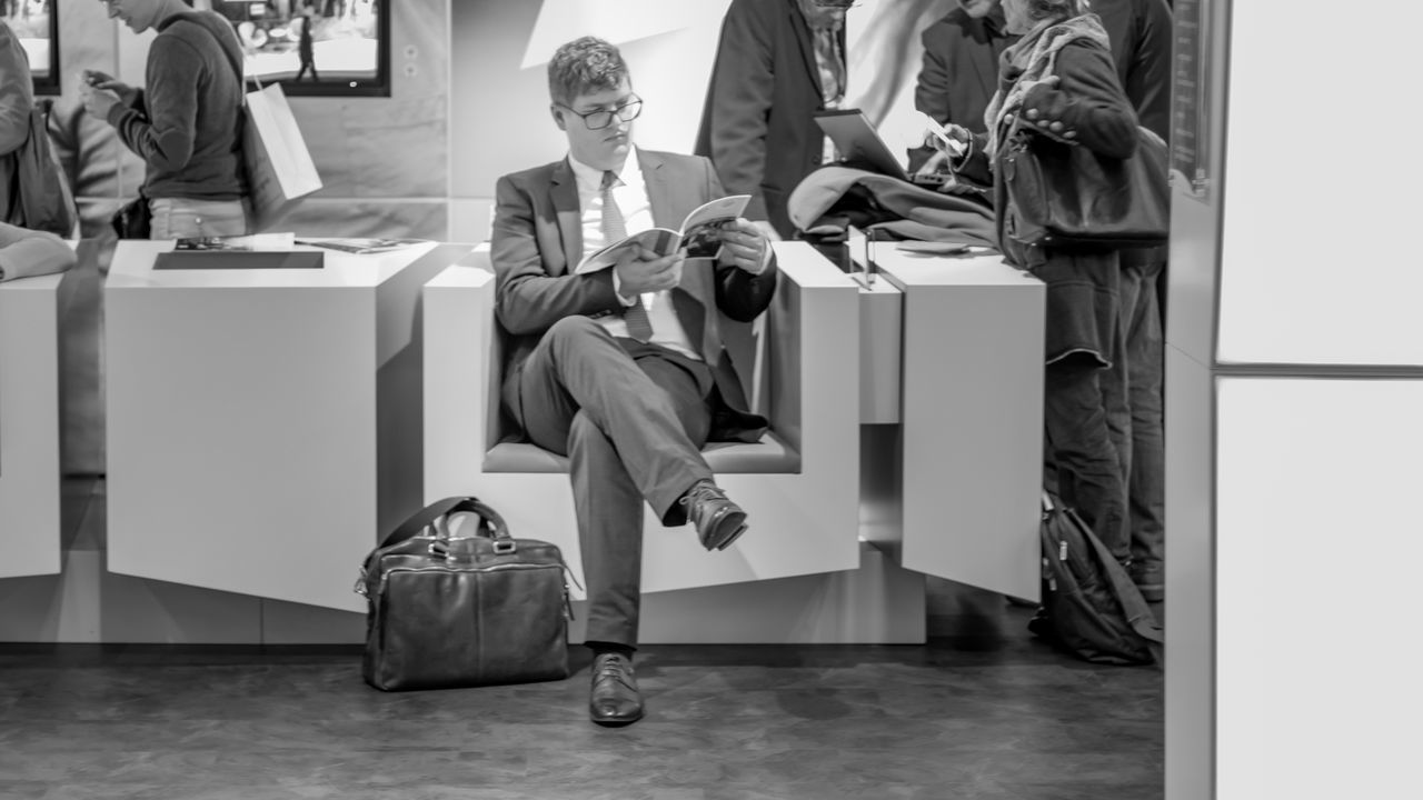 The Reader | #FBM16 #FBM16 500px Black & White Black And White Blackandwhite Blackandwhite Photography Buchmesse2016 Business Finance And Industry EyeEm Best Edits EyeEm Best Shots EyeEm Best Shots - Black + White Fbm16 Frankfurt Low Section Men Person Sitting Street Photography Streetphoto_bw Streetphotography Thisiswhatweshare