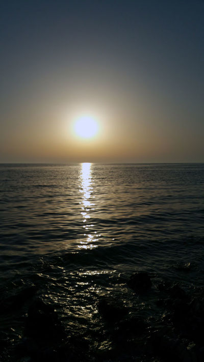 Beauty In Nature Calm Horizon Over Water Idyllic Majestic Nature No People Non-urban Scene Ocean Orange Color Outdoors Reflection Remote Rippled Scenics Sea Seascape Sky Sun Sunbeam Sunlight Sunset Tranquil Scene Tranquility Water