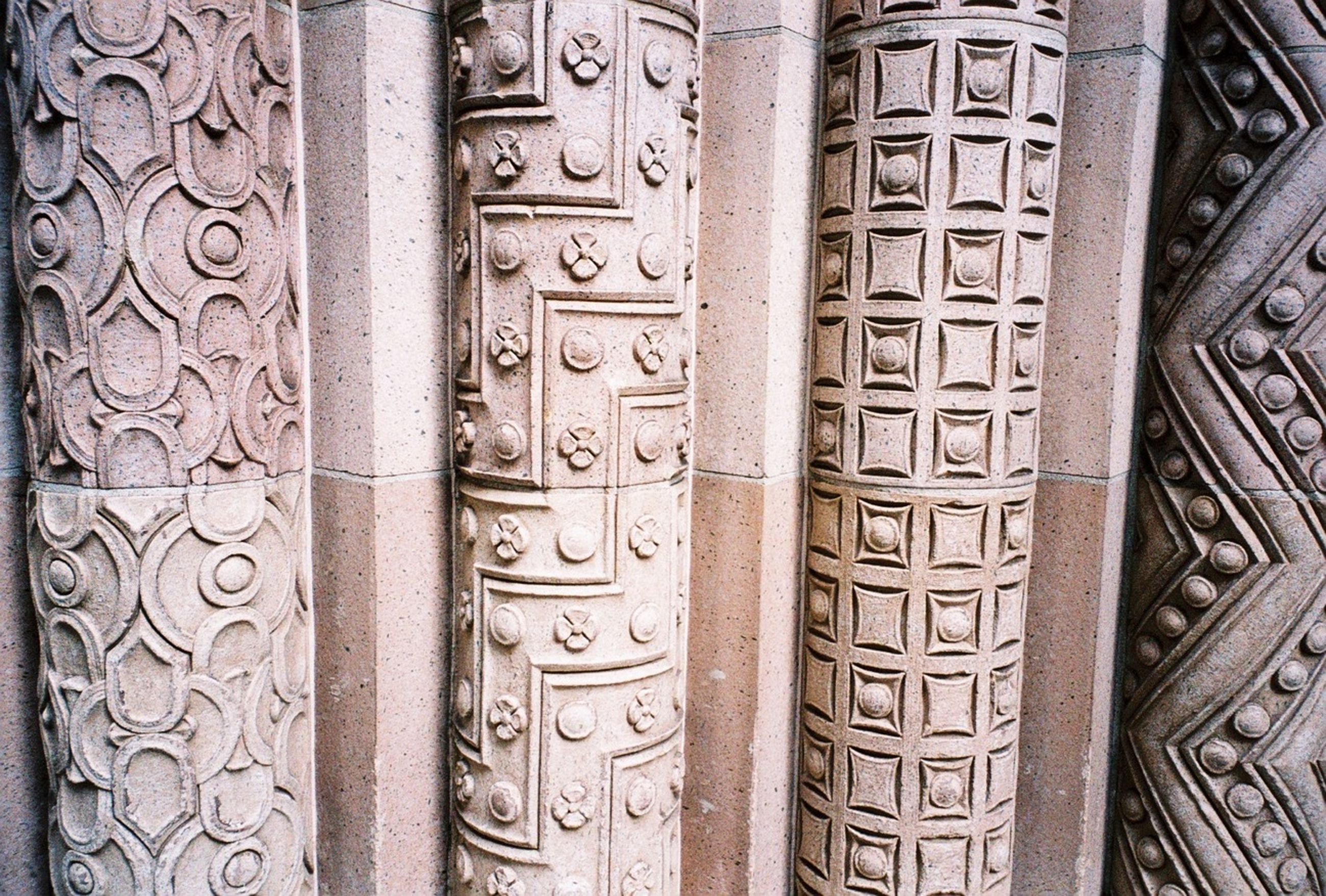 architecture, ornate, design, art and craft, full frame, pattern, built structure, backgrounds, art, carving - craft product, creativity, indoors, religion, low angle view, history, carving, building exterior, architectural feature, place of worship, close-up