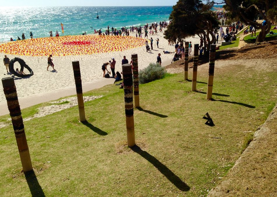 Cottesloe Beach, Western Australia-circa March 2014: Sculptures by the Sea Western Australia Weekend Activities Vacations Sculptures By The Sea Sculpture Recreational Pursuit Perth Outdoors Ocean Incidental People Expressive Sculpture Enjoyment Cottesloe Beach Connection Colors Clear Sky Built Structure Beach Art Event Art Abstract Beach Festival Flags Red And Yellow Outdoor Sculpture