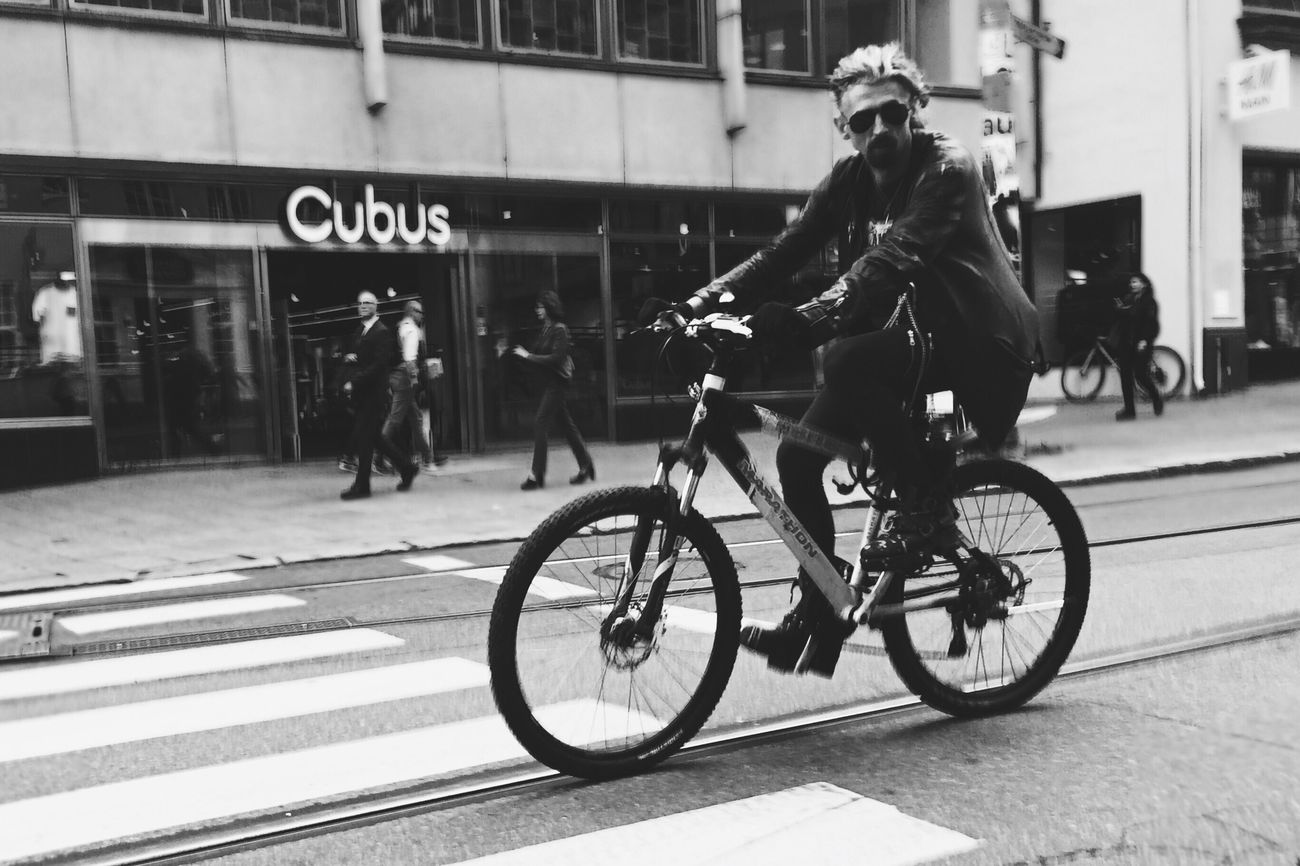 Biker • Oslostreets Streetsofoslo Streetphotography Black & White Streetbwcolor Building Exterior Street Cycling One Person Transportation
