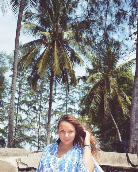 Uniqueness Girl Russian Russian Girl Thailand Palms Looking At Camera Portrait One Person Young Adult Palm Tree Real People Smiling Blond Hair Only Women Nature Young Women People Outdoors Front View Travel