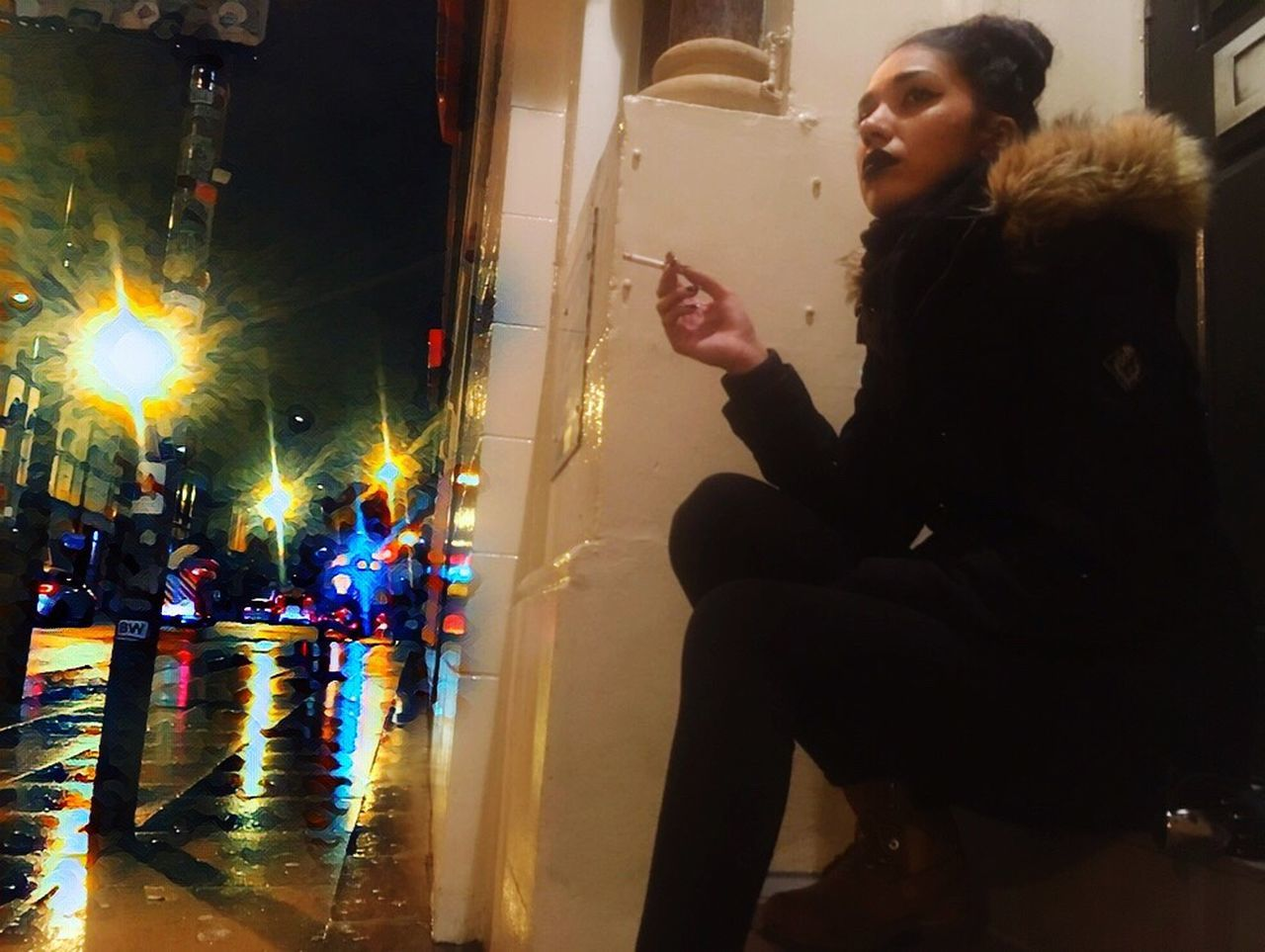 real people, night, one person, reflection, leisure activity, lifestyles, illuminated, sitting, full length, women, outdoors, young adult, young women, warm clothing, city, people