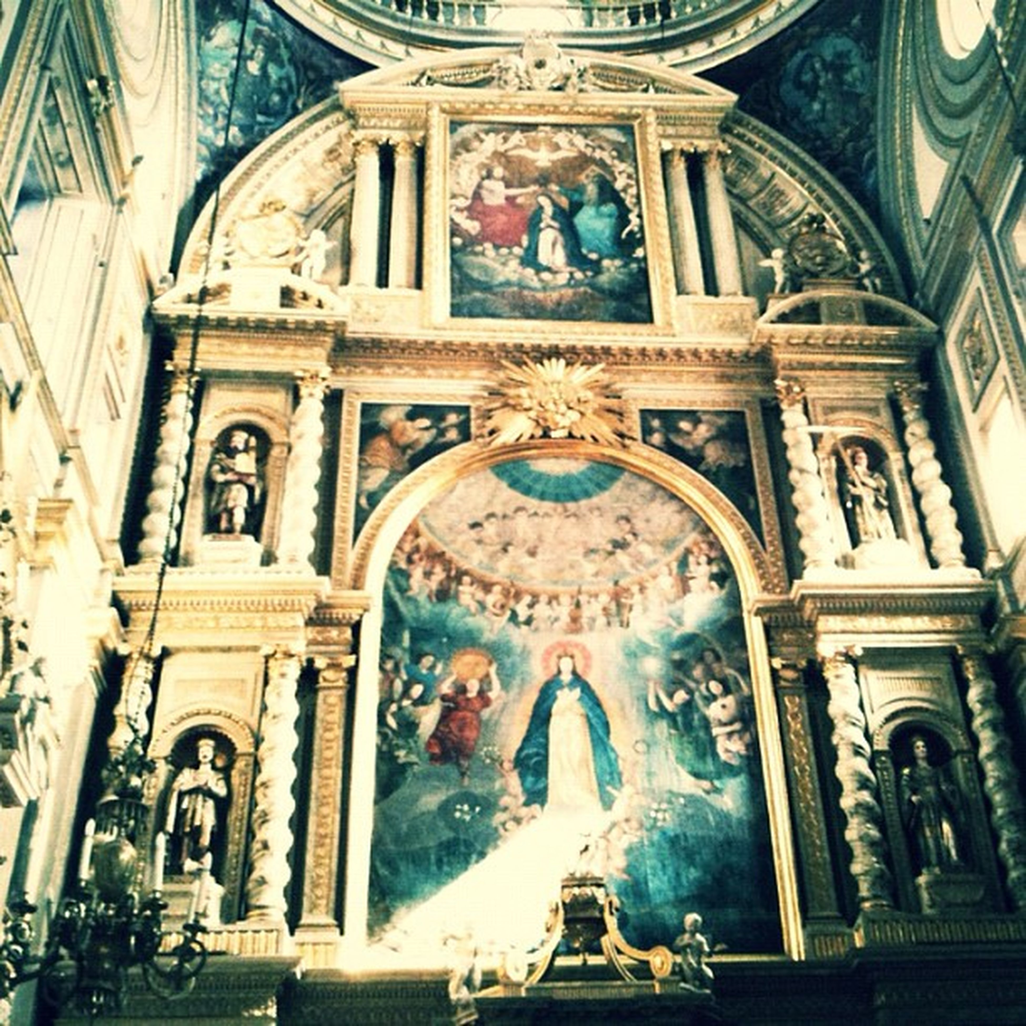 architecture, art and craft, place of worship, religion, art, human representation, low angle view, built structure, church, spirituality, creativity, sculpture, building exterior, statue, cathedral, arch, ornate