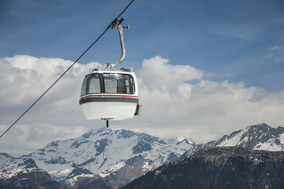 Blue Cable Cable Car Chair Lift Chalet Cloud - Sky Clouds Day Europe France Fun Gondola Holiday Mountain Range Background Nature Negative Space Outdoors Overhead Cable Car Ski Ski Lift Skiing Sky Snowboarding Tourist Transportation