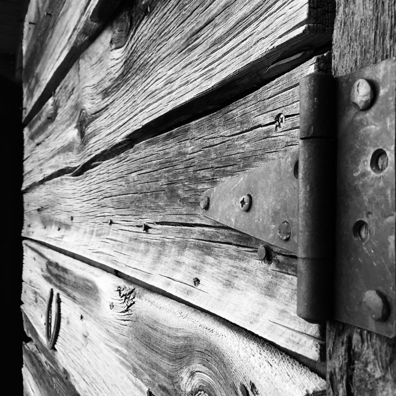 Through the door of the unknown Old Barn Old Barns Barn Door Old Door Old Doors Old Wood Old Wooden Door Woodgrain Good Luck Good Luck Horse Shoe Horse Shoe Perspective Door Hinge Hinge Weathered Composition Country Living Texture And Surfaces Taos New Mexico Black&white Black And White Photography Black And White Door Unknown Black & White