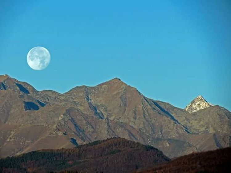 Moon Scenics Tranquil Scene Mountain Beauty In Nature Blue Tranquility Clear Sky Physical Geography Nature Majestic Mountain Range Idyllic Geology Non-urban Scene Remote Natural Landmark Ethereal Extreme Terrain Dramatic Landscape Feline Close-up Photography Themes Sun Back Lit