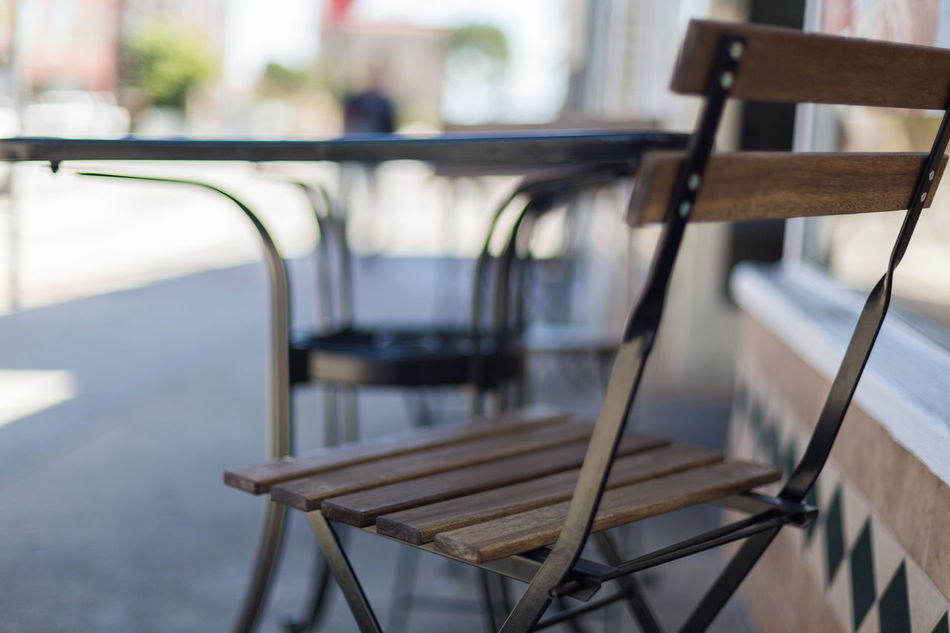 Architecture Building Building Exterior Cafe Cafe Entrance Chairs City Close-up Day Door Focus On Foreground Metal Tables Morning No People Outdoors Patio Roads Shade Shaded Shallow Depth Of Field Street Tables Town Urban Windows