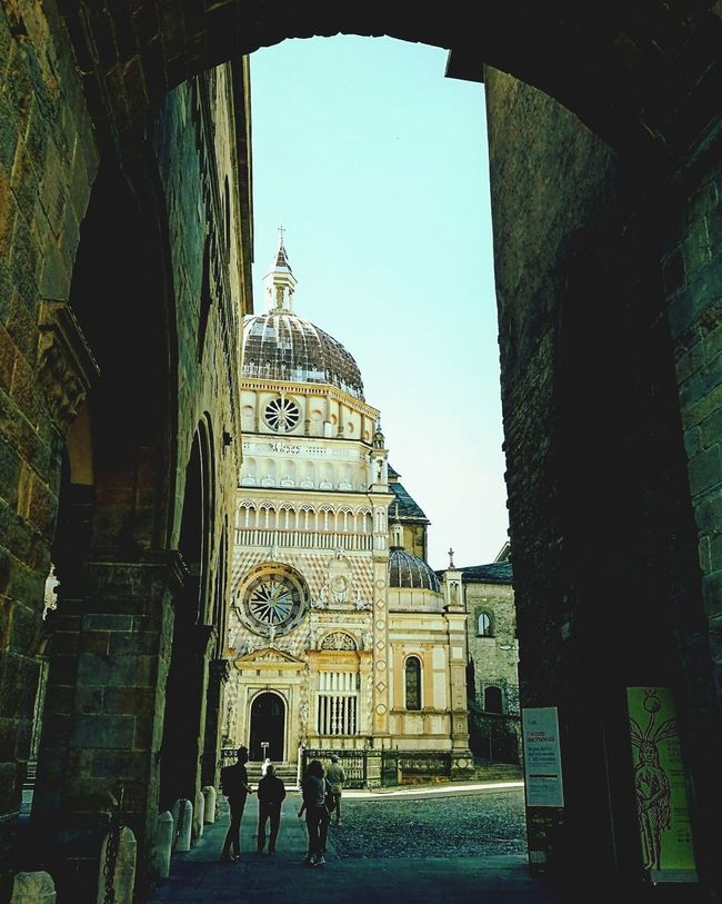 Famous Place Piazza Duomo Bergamo, Italia ColleoniChapel Architecture Built Structure Arch Building Exterior History Tourism Travel Destinations Famous Place Entrance Incidental People Tower Tourist Place Of Worship Façade Sky Day The Past Archway Architectural Feature Arcade Solitude