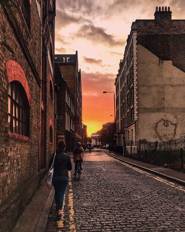 Architecture Sunset Built Structure Building Exterior Street Real People Sky River Thames London Sunset  London City Walking Cloud - Sky Rear View Outdoors Two People Men Full Length Women Lifestyles Togetherness Adult Day