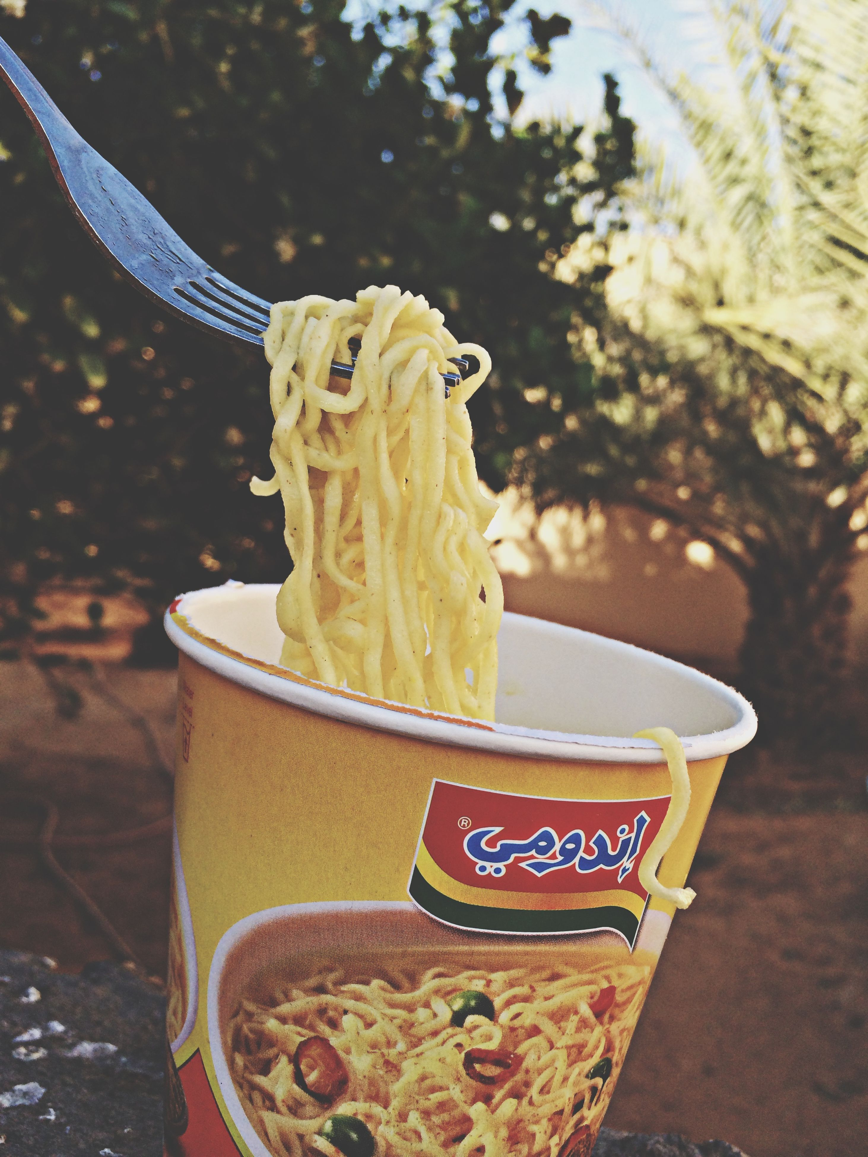 focus on foreground, close-up, food and drink, yellow, freshness, creativity, art and craft, art, still life, food, day, human representation, animal representation, outdoors, sweet food, no people, ice cream, incidental people, container, holding
