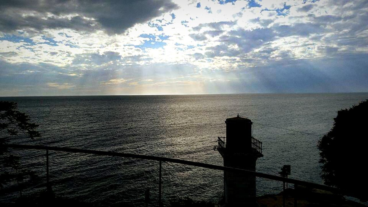 sea, water, horizon over water, railing, scenics, beauty in nature, nature, tranquility, sky, no people, tranquil scene, sunlight, outdoors, day, cloud - sky, fishing pole, coin-operated binoculars