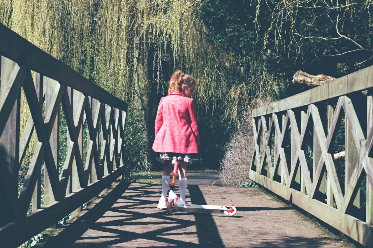 Children Playing Having Fun Park Scooter Taking Photos Pink Nature Trees Nature_collection Bridge Sunlight Eye4photography  Shootermag EyeEm Gallery Shadow Darkness And Light Showcase April Light And Shadow Walking Around
