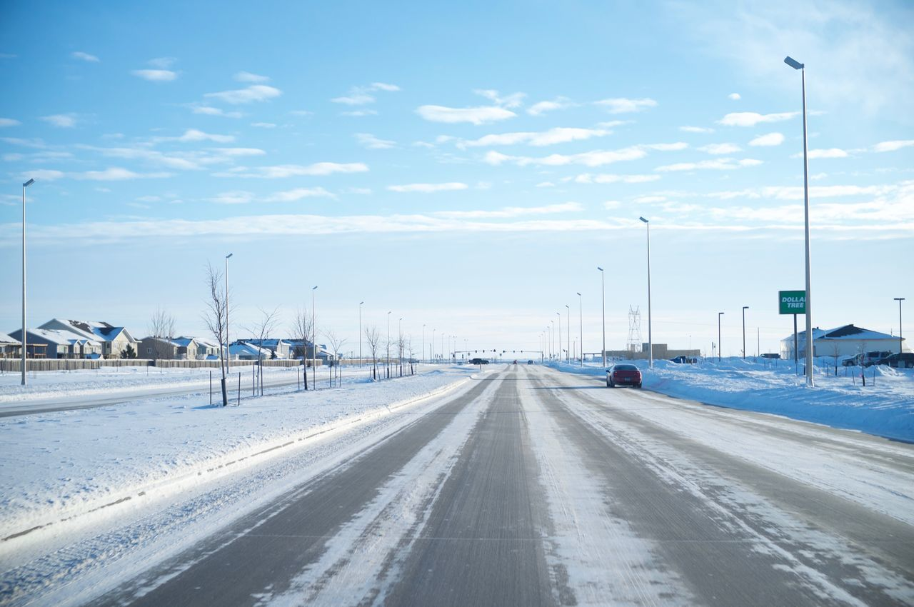 Car City Cloud - Sky Cold Temperature Day Fargo Nature No People North Dakota Outdoors Road Sky Snow South Fargo Street Light Transportation Travel Travel Destinations Winter Winter
