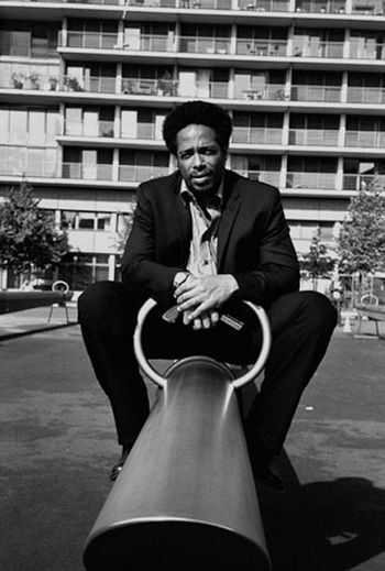 Actor Analogue Photography Black And White Photography Casual Clothing Confidence  Confidence  Famous People Filmset Front View Gary Dourdan Leisure Activity Lifestyles Men Person Perspective Real People Sitting Three Quarter Length Weapon