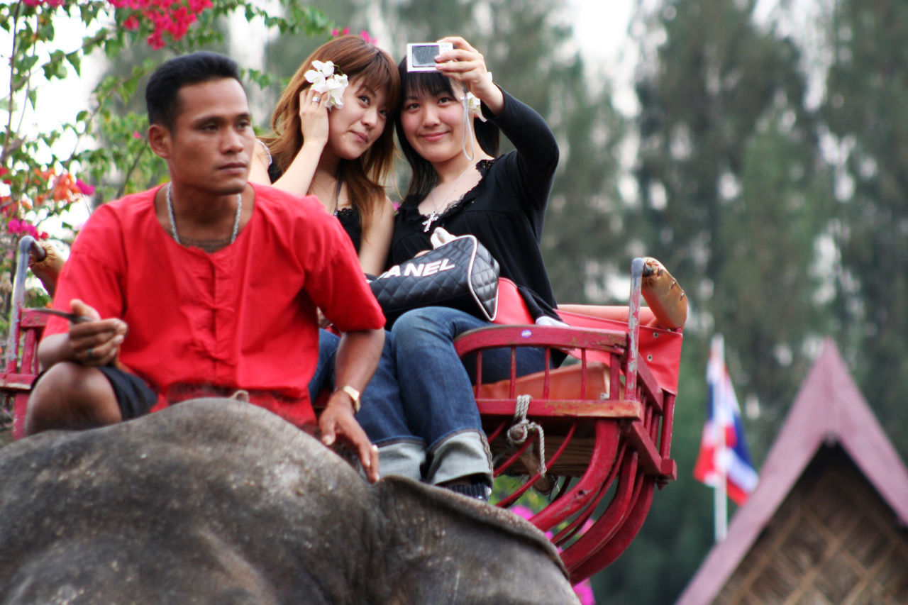 Casual Clothing Chanel Culture Contrast Day Elephant Enjoyment Fun Happiness Label Leisure Activity Outdoors Relaxation Selfie Sitting Telling Stories Differently Tourism Tourists