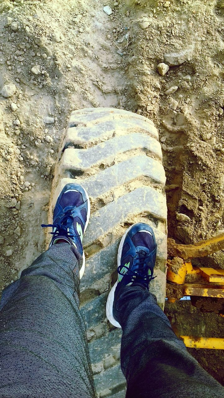human leg, low section, personal perspective, shoe, one person, human body part, jeans, standing, human foot, real people, men, day, leisure activity, outdoors, lifestyles, one man only, close-up, people, adult, adults only