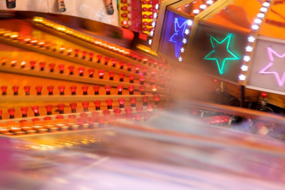 """Kill two souls in my breast."" Love and hate funfairs at the same time. Love the lights. Blurry Carousel Colorexplosion Colorful Funfair Having Fun Illuminated In Motion Lightbulb Motion Blur Multi Colored Neon Color Neon Lights Orange Color Red Speed Stars"