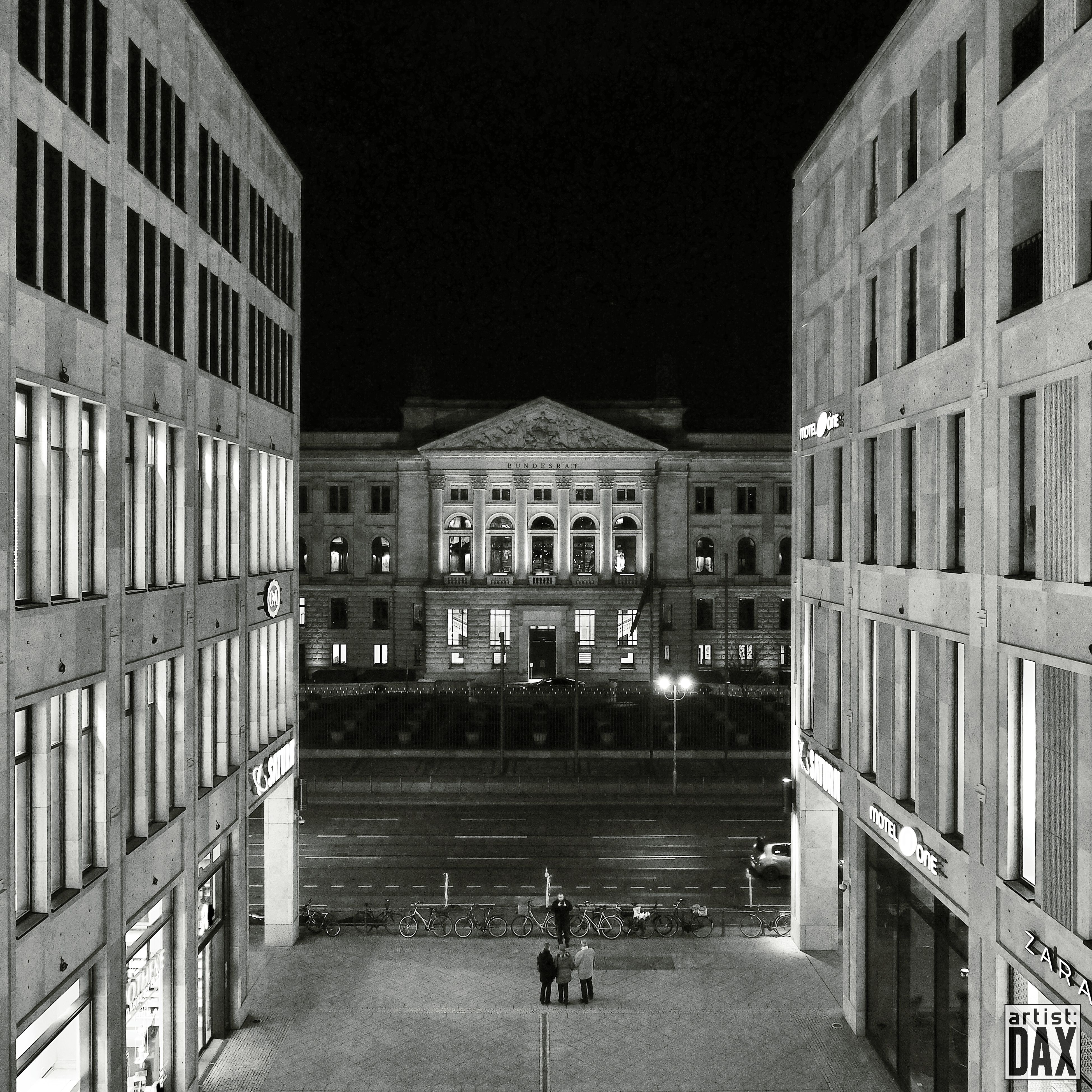 architecture, building exterior, built structure, men, lifestyles, person, walking, leisure activity, city, building, city life, full length, unrecognizable person, facade, residential building, residential structure, night