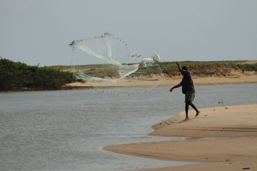 Fisherman with his fishingnet tries to catch fish from the river African Benin Fishing Net Grand Popo Mono River Nature River Collection River View Riverside Africa Fisherman Fishing Nature Nature_collection River River Side Riverbank Riverscape Riverside Photography Riverview Sand Sand & Sea Water Water Collection  Waterfront